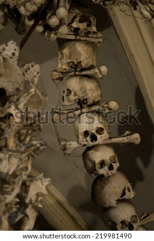 old bones and skulls in the Gothic vault of Kutna Hora. Ossuary. - stock photo