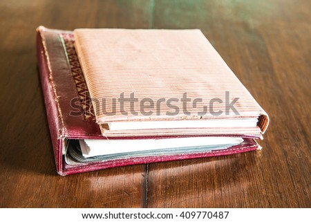 Old book and antique documents on wood table