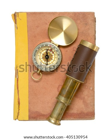 Old book and compass and spyglass on white background