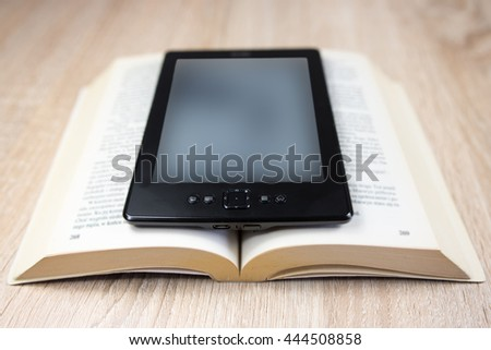 Old book and modern one - stock photo