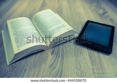 Old book and modern one, vintage photo - stock photo