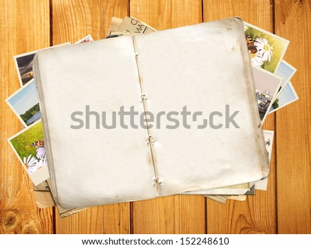 Old book and photos. Objects over wooden planks - stock photo
