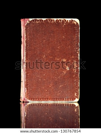 Old book cover, vintage texture reflected in black surface - stock photo