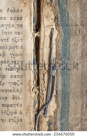 Old book cover, vintage texture with greek letters  - stock photo