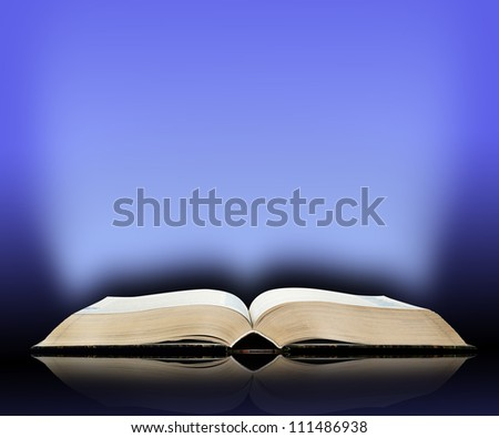 Old book, mystical blue light  background - stock photo