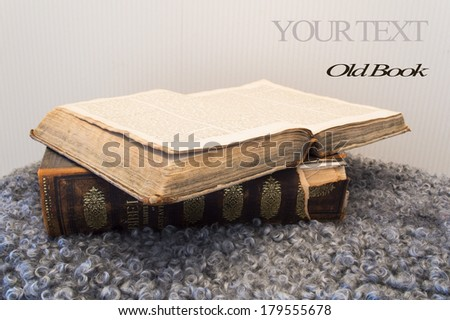 Old Book on carpet.Selective focus  - stock photo