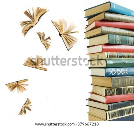 Old book pile and open books flying away isolated on white background - stock photo