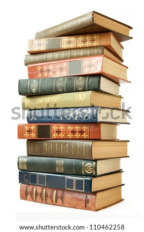 Old book pile isolated on white background - stock photo