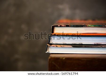 Old book stack on shelf - stock photo