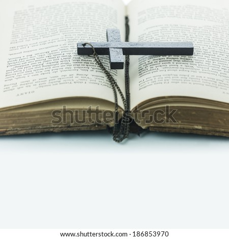 Old book with a cross on white background