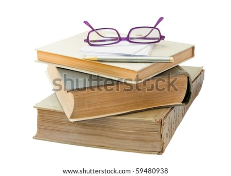Old book with glasses and plates for the notes. - stock photo