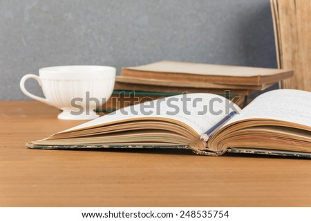 old book with pencil and coffee - stock photo