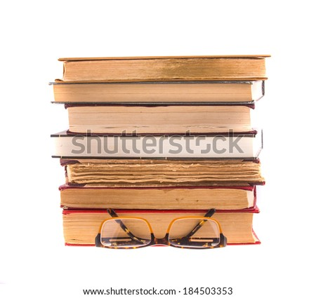 Old books and glasses isolated on white background.