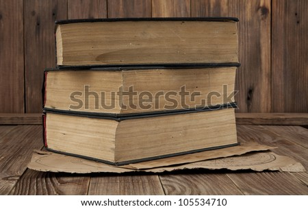 old books and maps on a wooden background - stock photo