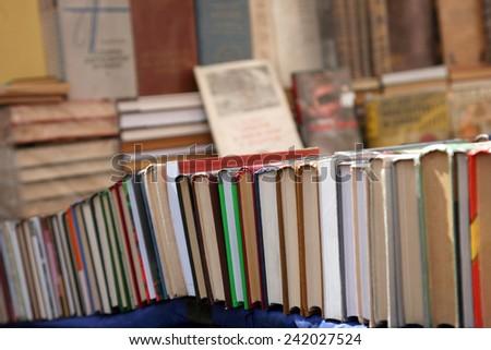 old books at the flea market - stock photo