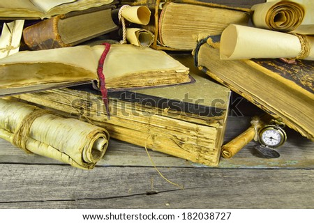 Old books background with pocket watch and copy space