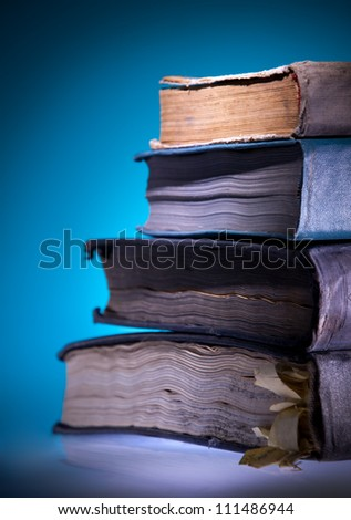 Old books, blue light  background - stock photo