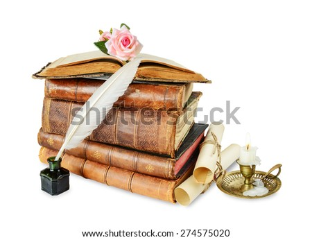 Old books, burning candle in candlestick, white feather in inkpot, rose flower and scroll with stamp, isolated on white background - stock photo
