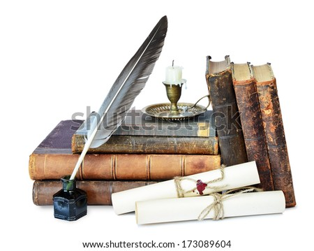 Old books, candle in candlestick, feather in inkpot and scroll with stamp - stock photo