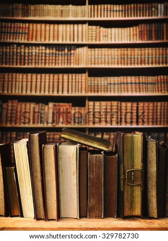 old books in a library. - stock photo