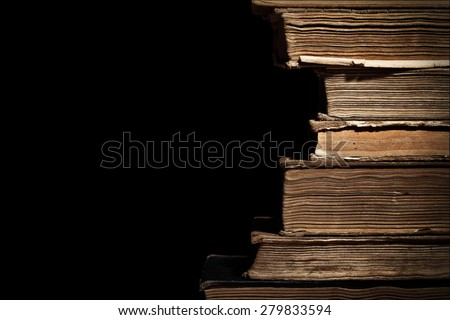 Old books in a stack isolated with space for text - stock photo