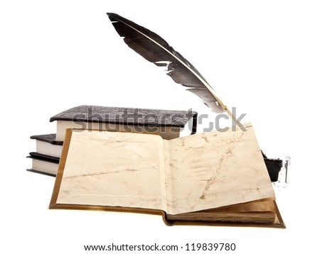 old books, ink-pot and feather on a white background - stock photo