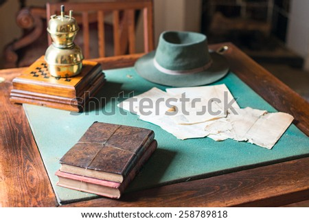 Old books lying on the dusty table. - stock photo