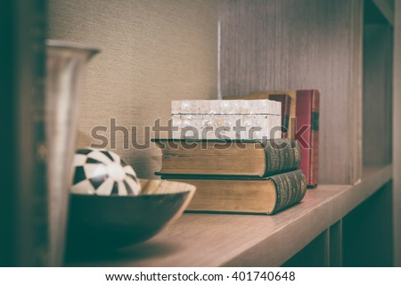 Old books on book shelf in the living room - stock photo