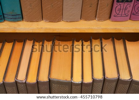 Old books on bookshelf - stock photo