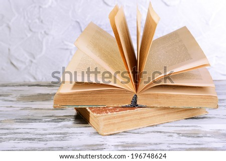 Old books on table on grey background
