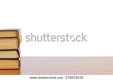 Old books on the shelf. Retro books on the table - stock photo