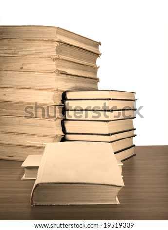 Old books on the table isolated