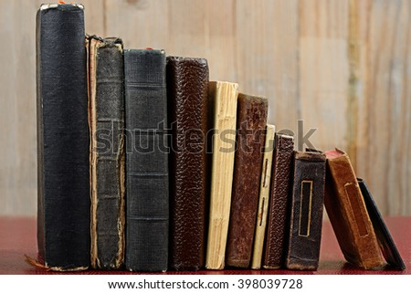 old books on wood background