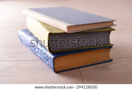Old books on wooden background - stock photo
