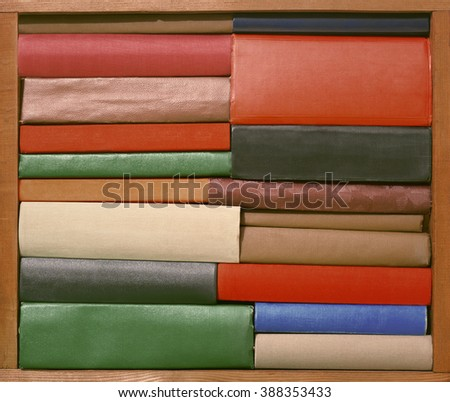Old books on wooden brown shelf