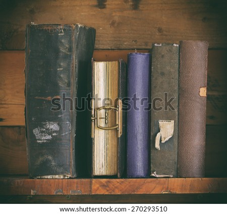 old books on wooden shelf.  - stock photo