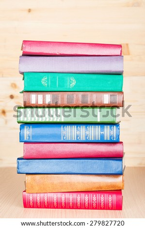Old books on wooden shelf - stock photo
