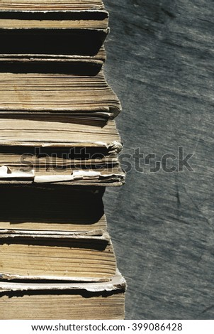 Old books. Pile of old books on a wooden background, close up - stock photo