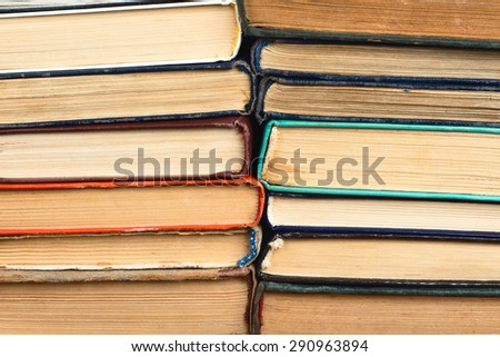 old books stacked on each other - stock photo