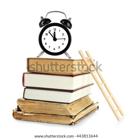 Old books with alarm clock and wooden ladder isolated on white - stock photo