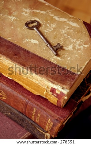 Old books with old key. - stock photo