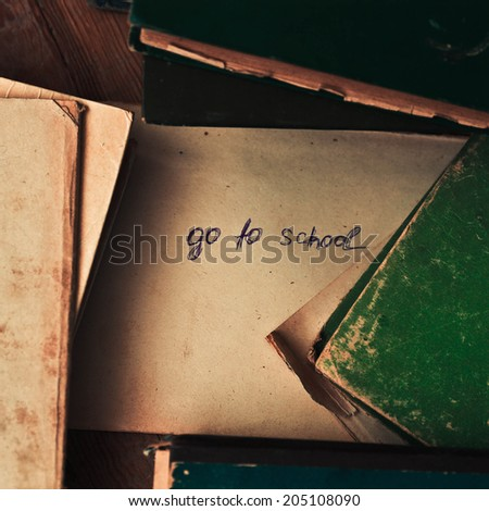 old books with the plate  go to school - stock photo