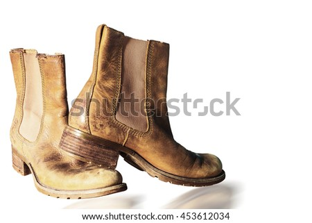 Old boots on the white background.