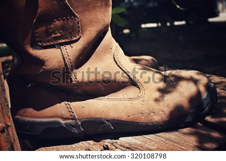 Old boots with shadow