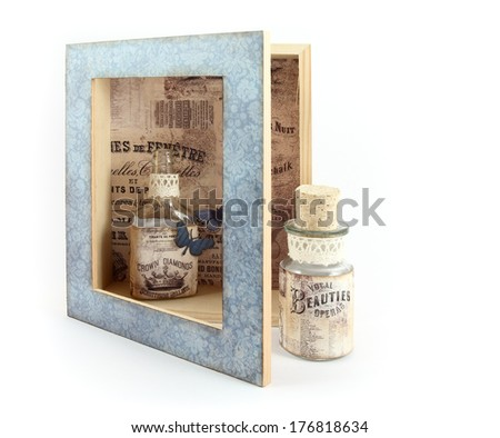 Old bottles with labels made from old ads in open box - stock photo