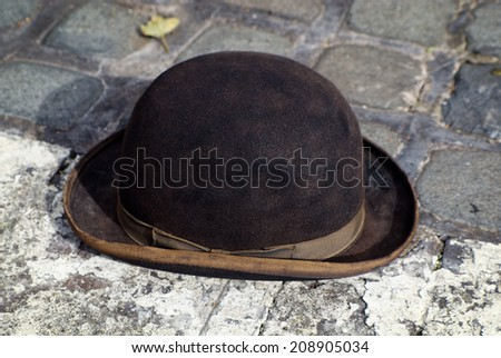 Old bowler or derby hat with vintage filter applied to image - stock photo