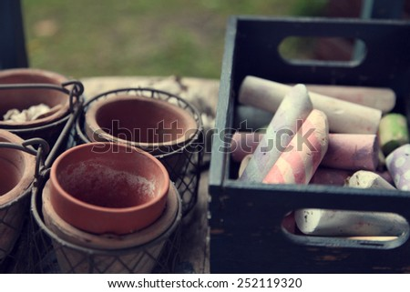 Old box of chalk in the garden - stock photo