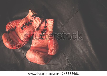 old boxing gloves concept - stock photo
