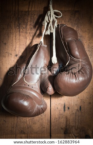 old Boxing Gloves hanging on wooden wall