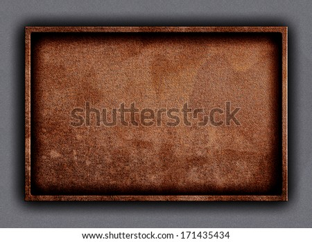 Old brass bright brown metal plate or name board framed and nailed on blue concrete stone wall background - stock photo